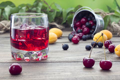 Cherry juice. On a table in the early morning Stock Images