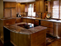 Cherry Kitchen Horizontal. Newly remodeled kitchen with stainless, wood and stone countertops Stock Photo