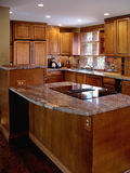 Cherry Kitchen Vertical. Newly remodeled kitchen with stainless, wood and stone countertops Stock Image
