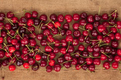 Cherry lies on sackcloth Royalty Free Stock Photo