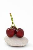 Cherry like zen. Three cherry on a zen stone. rock like zen Royalty Free Stock Images