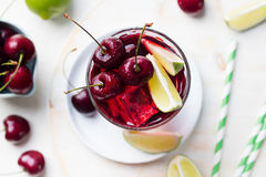 Cherry Limeade, lemonade, cola, cocktail in a tall glass Top view Copy space Royalty Free Stock Image