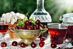 Cherry liqueur in crystal carafe and fresh fruits Stock Images