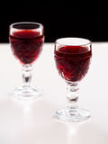Cherry liqueur in crystal glasses Royalty Free Stock Image