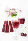 Cherry liqueur in crystal glasses Stock Photography