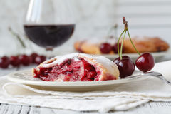 Cherry liqueur in glasses and bowl with fresh cherries royalty free stock image