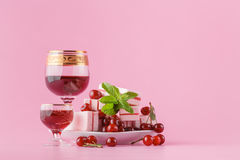 Cherry liqueur on pink Stock Photos