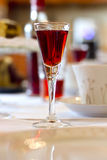 Cherry liqueur shot. On the kitchen table Stock Images