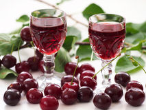 Cherry liqueur and sour cherries Royalty Free Stock Photos