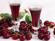 Cherry liqueur and sour cherries Stock Images