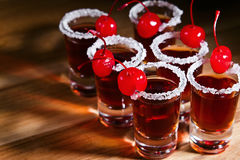 Cherry liquor. With berry on wooden table Royalty Free Stock Photo
