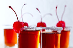 Cherry liquor. With berry on wooden table Stock Photos