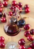 Cherry liquor and juicy berries . Cherry liquor and juicy ripe berries Stock Image