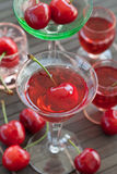 Cherry liquor in little glasses Royalty Free Stock Photos