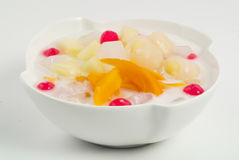 Cherry, lychee, cherry and peach with coconut milk Stock Photography