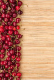 Cherry lying on bamboo mat Royalty Free Stock Image