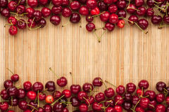 Cherry lying on bamboo mat Royalty Free Stock Photography