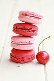 Cherry macarons Stock Photos