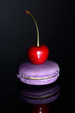 Cherry on a macaroon Stock Image