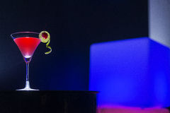 Cherry martini cocktail drink at night in modern bar Stock Photo