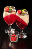 Cherry and milk jelly in the glasses topped mint leaves and stra Stock Image