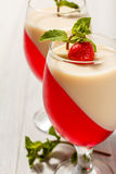 Cherry and milk jelly in the glasses topped mint leaves and stra Royalty Free Stock Image