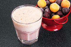 Cherry milk shake in a glass cup Stock Images