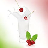Cherry with milk splash Stock Photography
