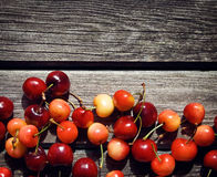 Cherry on old wooden board Royalty Free Stock Photos