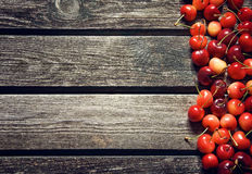 Cherry on old wooden board Stock Photos
