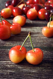 Cherry on old wooden board Royalty Free Stock Photography
