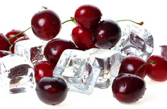 Cherry over ice cubes. Royalty Free Stock Photos