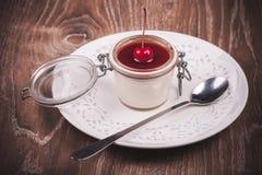Cherry panna cotta in jar Royalty Free Stock Photo