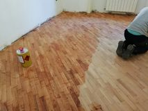 Parquet during grouting. Cherry parquet during the grouting phase after sanding Royalty Free Stock Photo