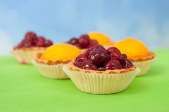 Cherry, peach and jelly tarts Royalty Free Stock Photography