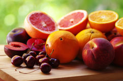 Cherry, peaches and citric fruits Royalty Free Stock Photo