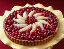 Cherry and pear tart on yellow plate Stock Photos