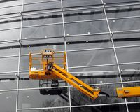 Cherry picker. Cerry picker in front of a modern building Royalty Free Stock Photo