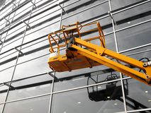Cherry picker. In front of a modern building stock photography