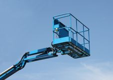 Cherry Picker. The Top of a Blue Mechanical Lift Vehicle - Cherry Picker royalty free stock photography