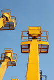 Cherry picker. And blue sky stock photography