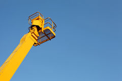 Cherry picker. And blue sky stock photo