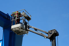 Cherry Picker. Worker on a cherry picker doing maintainance work royalty free stock image