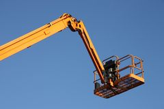 Cherry Picker. The Arm and Platform of a Yellow Cherry Picker royalty free stock photo