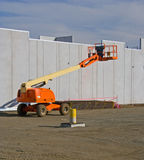 Cherry Picker 4219. Elevated cherry picker on construction site royalty free stock images