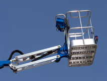 Cherry Picker. Brand new cherry picker (basket) extended up high stock photography