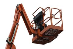 Cherry Picker. An Orange Mechanical Lift - Cherry Picker royalty free stock image