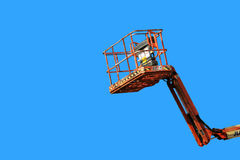 Cherry picker on blue Royalty Free Stock Photo