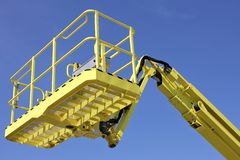 Cherry picker. Bucket of cherry picker against blue sky stock image