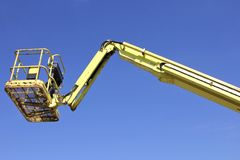 Cherry picker. Bucket of cherry picker against blue sky stock photo